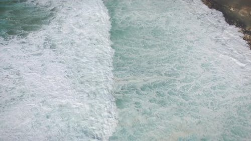 Aerial view of waves crashing on the shore at Punta Guadalupe.
