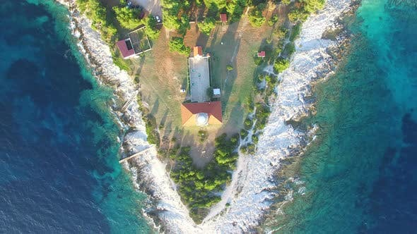 Flying over lighthouse, Croatia with a red tiled roof