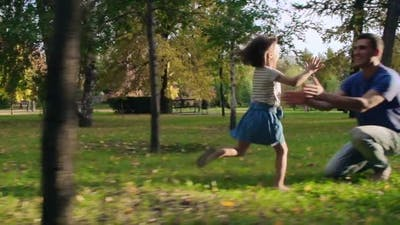 Excited Little Girl Running to Father
