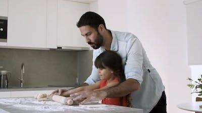 Focused Dad Teaching Daughter To Bake