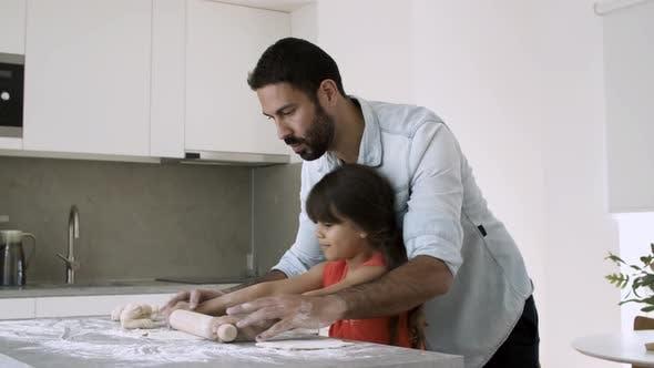 Thumbnail for Focused Dad Teaching Daughter To Bake