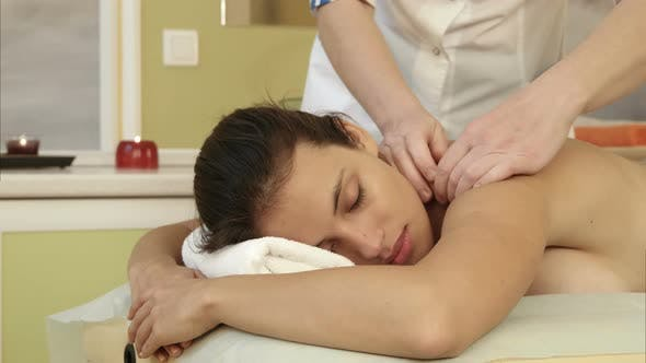 Thumbnail for Young Woman Enjoying Shoulder Massage in a Spa