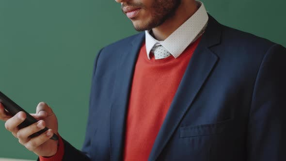 Thumbnail for Young Businessman Browsing the Web on Smartphone