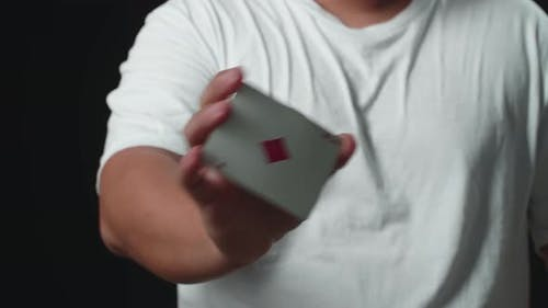 Magician Showing His Trick With Usual Cards, Magician Changes Card