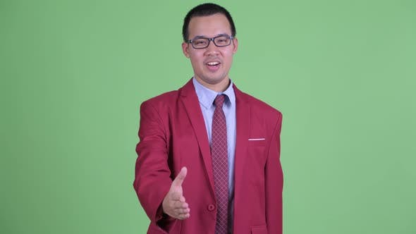 Thumbnail for Happy Asian Businessman with Eyeglasses Giving Handshake