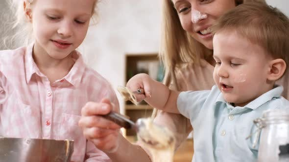 Cover Image for Happy Blonde Mum Making Cupcakes with Kids