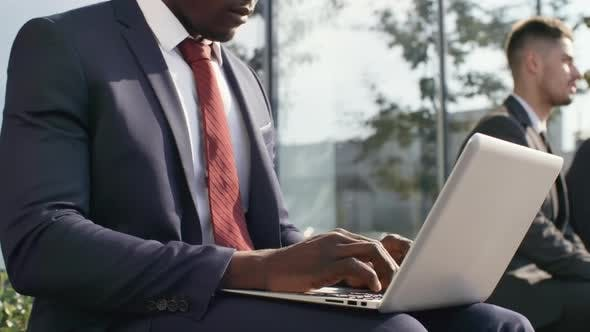 Thumbnail for Black Businessman Working on Computer Outdoors