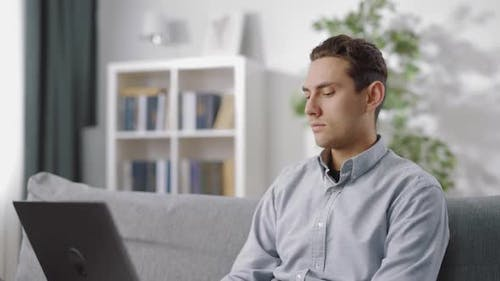 Man Using Laptop for Remote Work