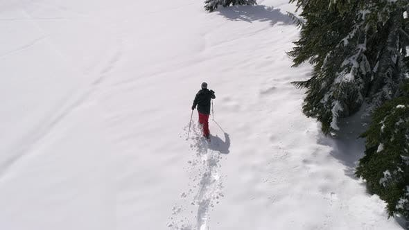 Thumbnail for Drone Shot Of Snowshoeing Deep In Forest Mountain Backcountry With Fresh Powder Snow