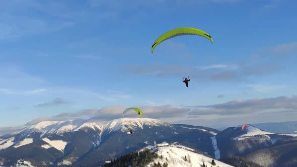 Thumbnail for Freedom Adventure of Paragliding Flying Above Winter Alpine Mountains, Free Flight Extreme Sport