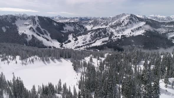 Thumbnail for Aerial Of Pacific Northwest Winter Ski Resort Stevens Pass From Skyline Lake