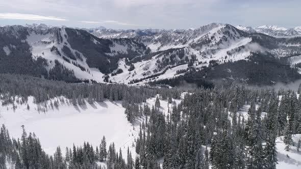 Cover Image for Aerial Of Pacific Northwest Winter Ski Resort Stevens Pass From Skyline Lake