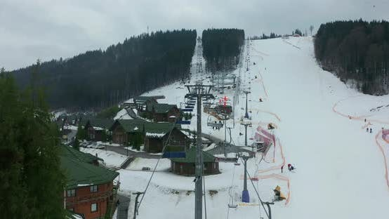 Thumbnail for Aerial View of Ski Lift for Transportation Skiers and Snowboarders on Snowy Ski Slope