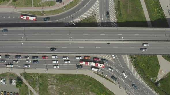 Freeway Intersection with Highway Overpass with Cars and Trucks over Two-Level Road Junction