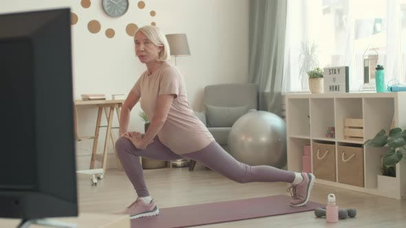 Thumbnail for Woman Doing Lunge Stretch