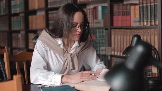 Thumbnail for Girl Studying in Library