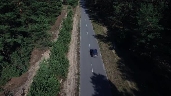 Thumbnail for Copter View Car Riding on Road. Copter Filming Car Riding on Highway