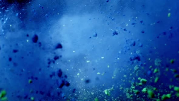Color Mix Slow Motion of Colored Blue and Green Powder