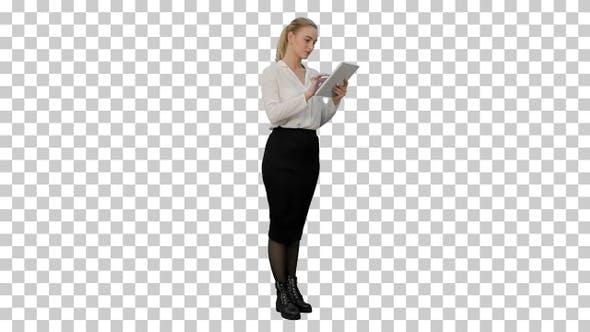 Businesswoman standin with digital tablet, Alpha Channel