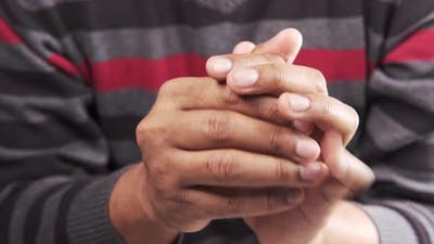 a Nervous Young Man Hand