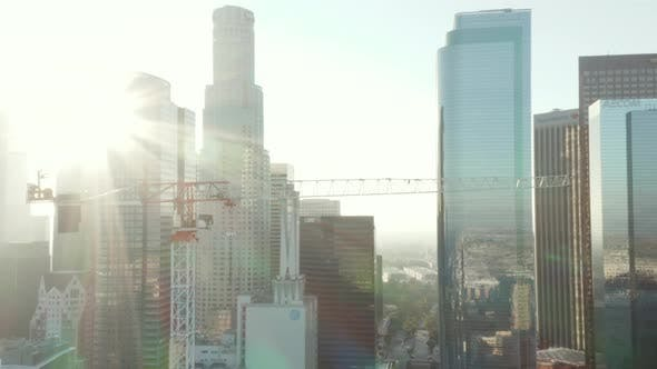 Thumbnail for AERIAL: Close Up of Construction Site Skyscraper Crane in Downtown Los Angeles, California Skyline