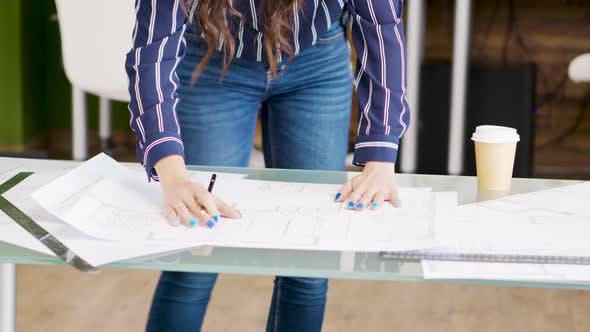 Cover Image for Close Up Hands of Female Architect Drawing on Blueprints