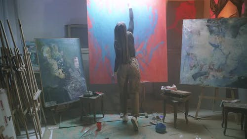 Art woman drawing abstract picture.