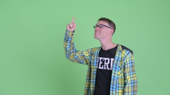Thumbnail for Portrait of Happy Nerd Man Talking While Pointing Up