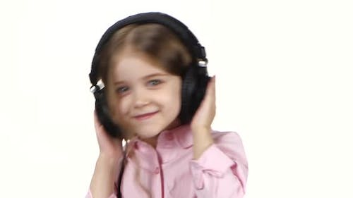 Baby Listens Music on Headphones and Shakes Head, Close Ups