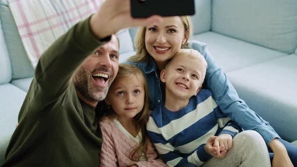 Thumbnail for Family making a selfie in living room