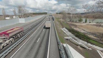 Top view of trucks driving on motorway in spring