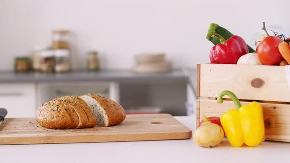 Thumbnail for Bread on Cutting Board and Vegetables at Home 4