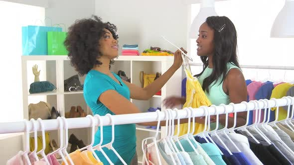 Thumbnail for African American friends buying dress with credit card