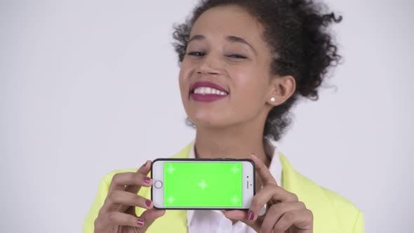 Thumbnail for Face of Young Happy Beautiful African Businesswoman Showing Phone