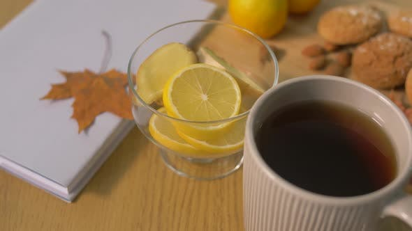 Thumbnail for Book, Lemon, Cup of Tea, Nuts and Cookies on Table