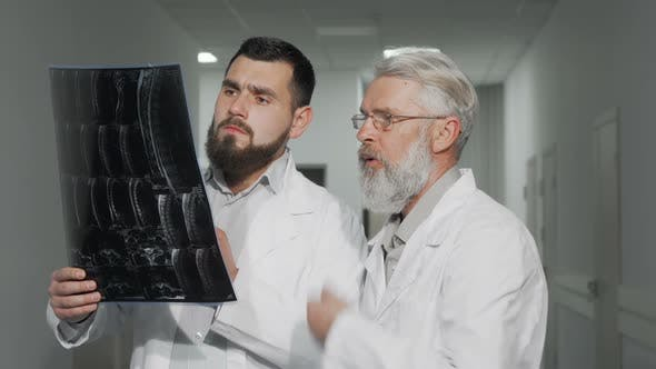 Thumbnail for Two Male Doctors Discussing MRI Scan of Their Patient