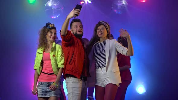 Thumbnail for Smiling Attractive Party People Taking a Selfie at the Nightclub