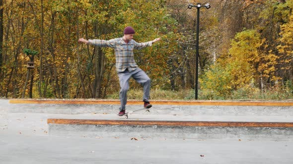 Thumbnail for Skater Practicing in the Autumn Concrete Skate Park Making Tricks and Rides in Ramp