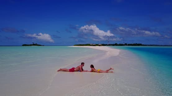 Young people on romantic honeymoon enjoy luxury on beach on white sand background 4K