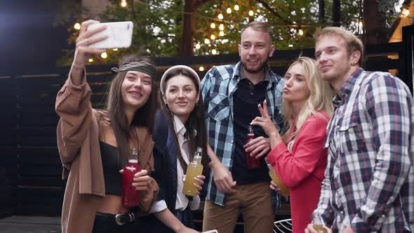 Thumbnail for Young People with Pleasant Smiles Making Selfie with Funny Faces in the Evening