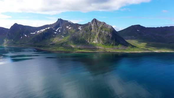 Norwegian rocky coast and mountain ridge