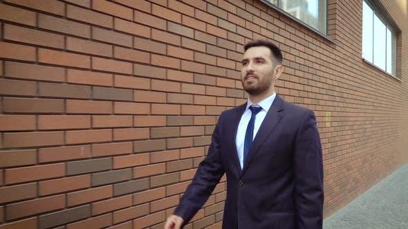 Thumbnail for Happy Successful Businessman Dancing In Wireless Earphones