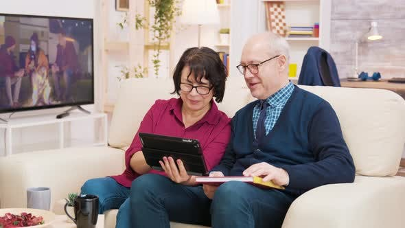Thumbnail for Old Couple Sitting on Sofa During a Video Call on Tablet