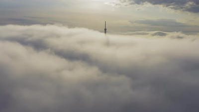 Aerial View of the Upper Part of the Broadcasting Tower in the Fog