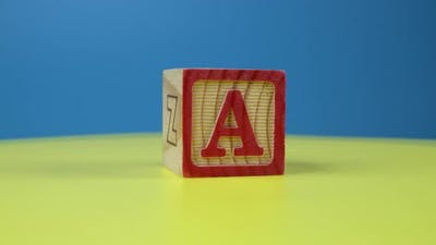 "Close up shot letter ""A"" alphabet wooden block"