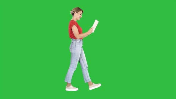 Thumbnail for Happy woman walking with tablet on a Green Screen, Chroma Key.