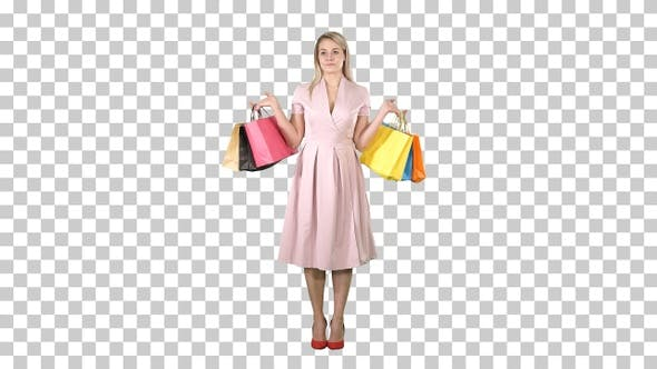 Thumbnail for Woman with Shopping Bags in Pink Dress Standing, Alpha Channel