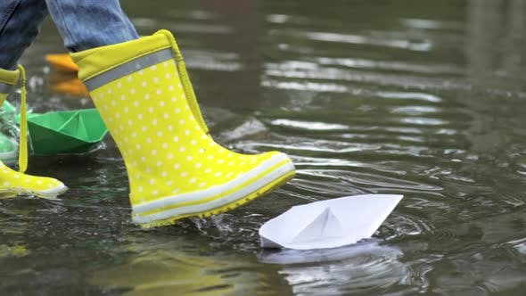 Thumbnail for Kids in Rubber Boots Playing with Paper Boats