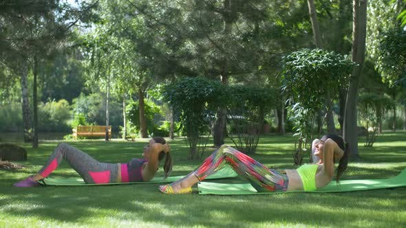 Active Fitness Females Doing Sit-ups on Yoga Mat