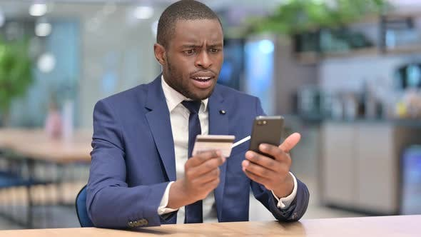 Cover Image for Online Payment Failure on Smartphone for African Businessman